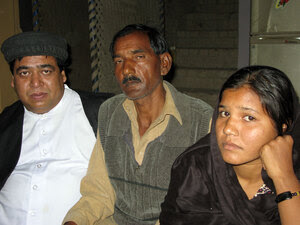 The Rev. Samson Dilawar, a Catholic priest, with Ashiq Masih, husband of Asia Bibi, and daughter Sidra