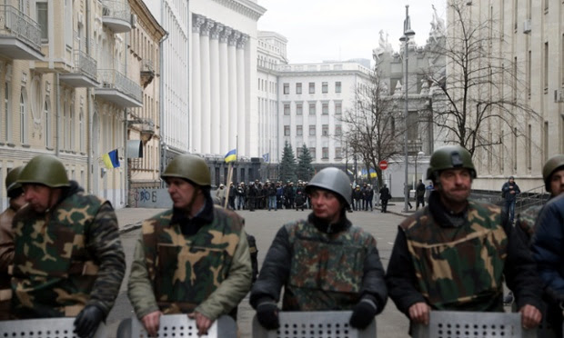 Anti-government protesters guard the  the Ukrainian Parliament building in Kiev.