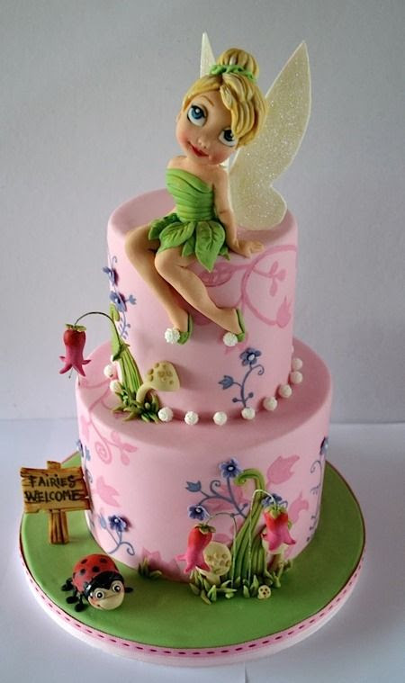 Tinkerbell cake - By Sweet Ruby Cakes  Look how pretty she is! And check out the flower silhouettes painted on the cake tiers, and the wooden sign, and that bitty little lady bug - so many great details. But really, that handmade Tink steals the show; from her vine-wrapped hair bun to her little shoe pom-poms, she's just perfection.