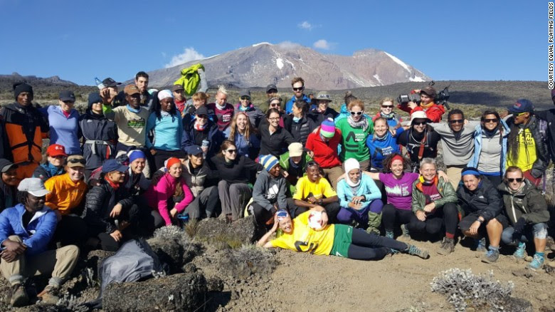 Female footballers celebrate on Mount Kilimanjaro after breaking the world record for the highest match ever played.