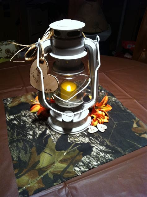 Camo wedding centerpiece! Maybe some more flowers & a few