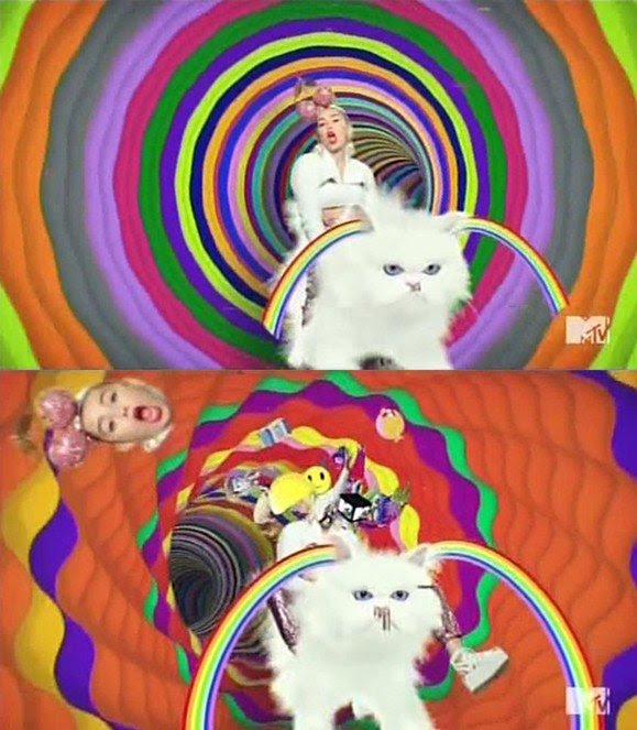 Continuando a tradição Beta Kitten, Miley Cyrus é visto litterally montando um gatinho com um par de cerejas sobre sua cabeça.  Para enfatizar sua diassociative estado MK escravo, ele aparece fora cabeça e um monte de porcaria (o que compõe sua persona alter) sai de seu corpo.