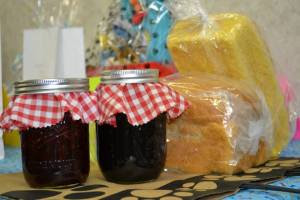 The bread and jam basket is people yummy! A jar each of home made strawberry and blackberry jam and a loaf of home made white bread and English muffin bread! These will put a smile in your morning! Thank you Chris Rozman for baking!