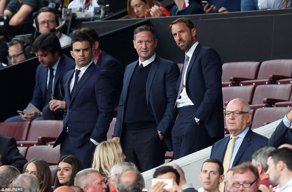 England manager Gareth Southgate watches from the Old Trafford stands with assistant coach Steve Holland