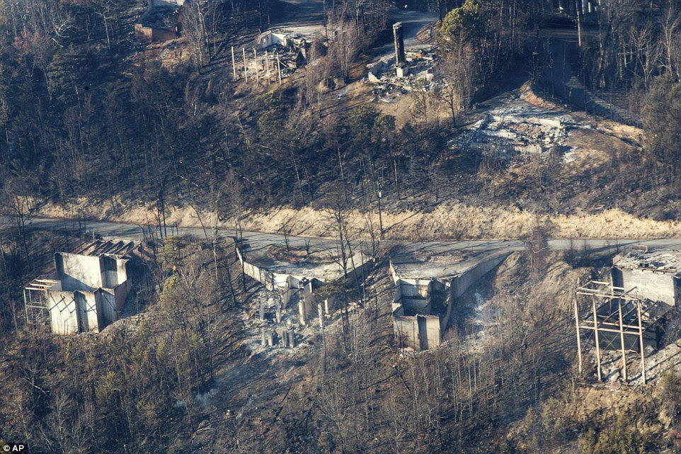 Burned structures are seen from aboard a National Guard helicopter after fires spread quickly on Monday night, when winds topping 87 mph whipped up the flames