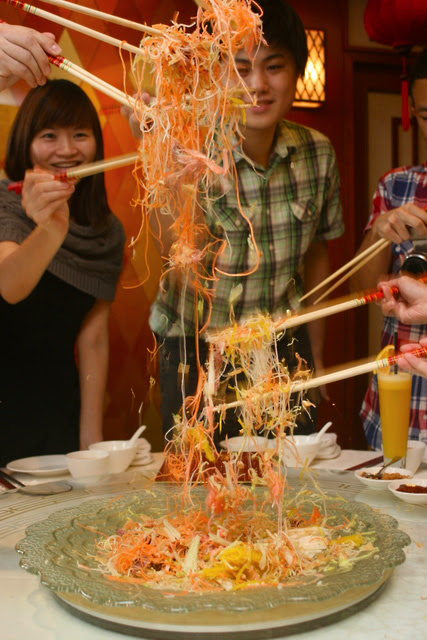Lo hei! As high as you can!