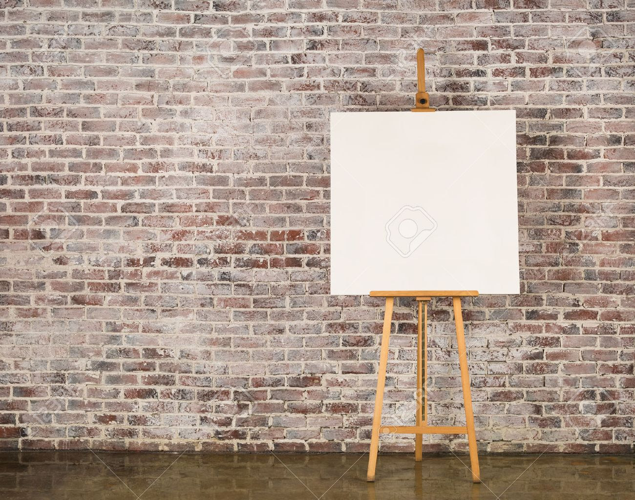 Easel With Blank Canvas On A Brick Wall Background Stock Photo ...