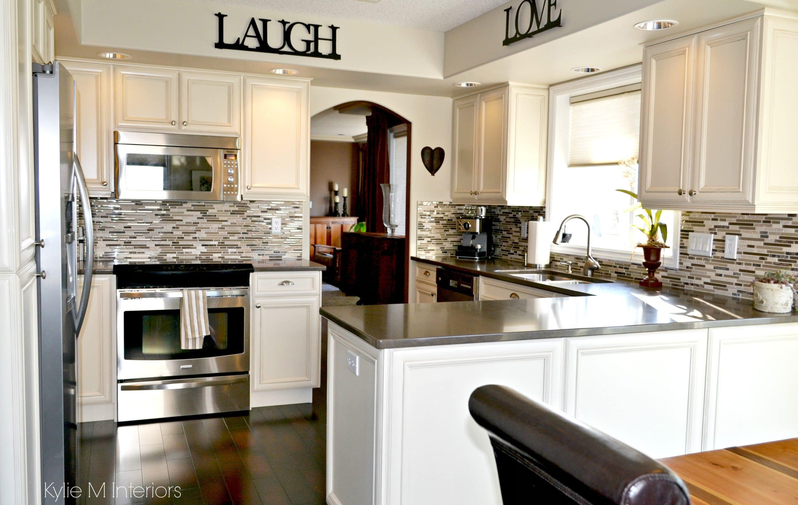 Oak kitchen remodel and update with painted cream cabinets ...