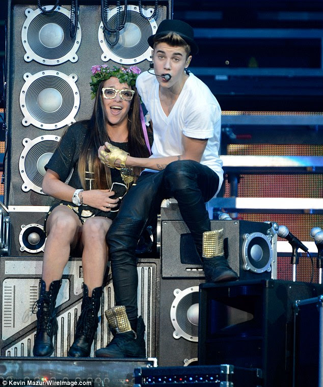 Lucky lady: The pop star dragged one special fan on stage to serenade her