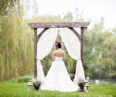 decorated wedding arch  burlap  sunflowers perfect