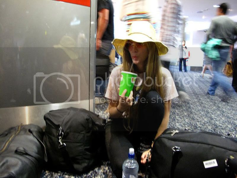 airport,travel,drinking,healthy,hat,luggage