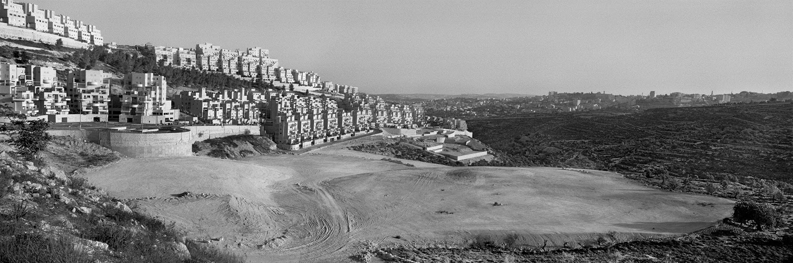 The Har Homa settlement, on a hill opposite Bethlehem, West Bank, 2009; photograph by Josef Koudelka from the exhibition 'This Place'