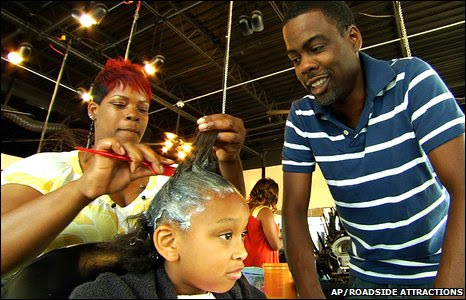 Chris Rock (R) in a scene from Good Hair