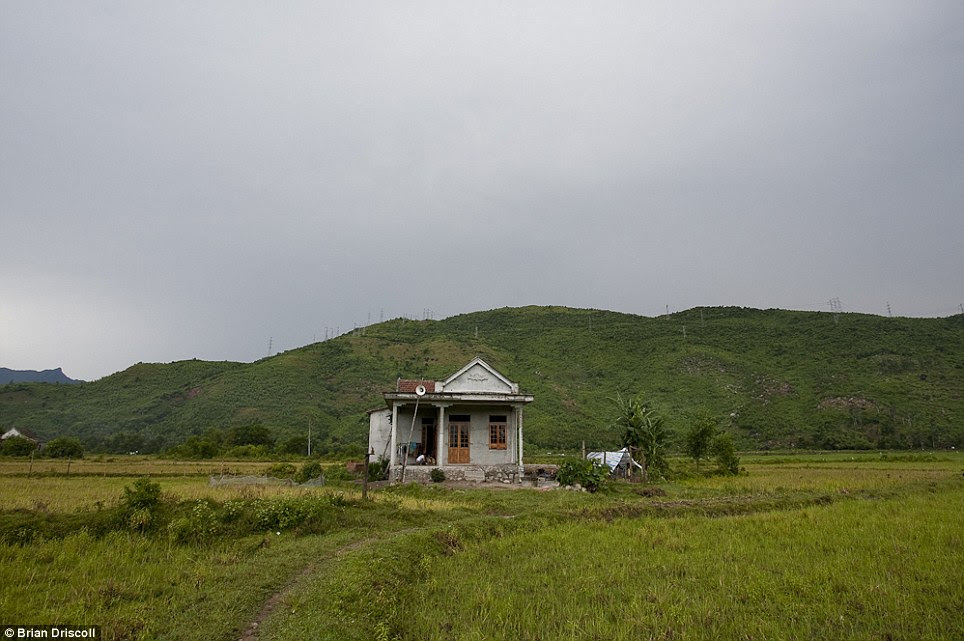 Bucolic setting: The house of Nguyen Pham, 11, an Agent Orange victim, in the district of Chi Linh, Vietnam