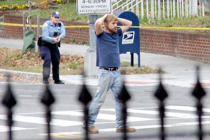 Edgar Maddison Welch, 28, of Salisbury, N.C., surrenders to police Sunday, December 4, 2016, in Washington, D.C. Welch, who said he was investigating a conspiracy theory about Hillary Clinton running a child sex ring out of a pizza place, fired an assault rifle inside the restaurant on Sunday injuring no one, police and news reports said.