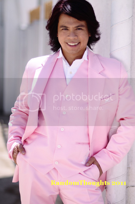 Peter Solis Nery standing in pink apparel