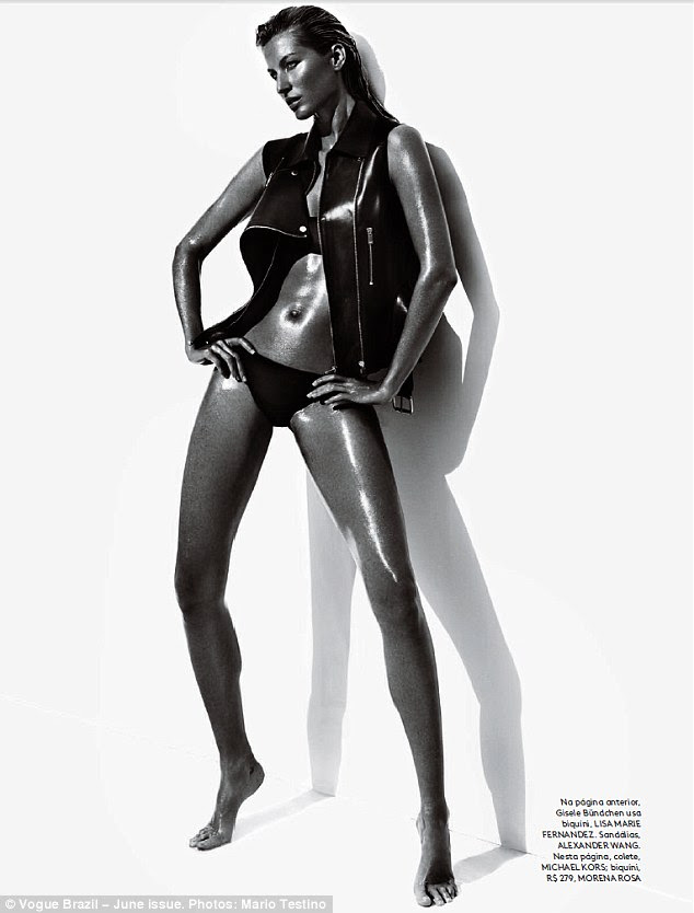Strike a pose: The Brazilian beauty also donned a fierce black leather motorcycle vest for the black-and-white shoot
