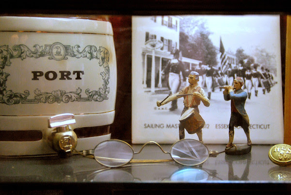 Port and Eyeglasses in a Showcase at The Griswold Inn
