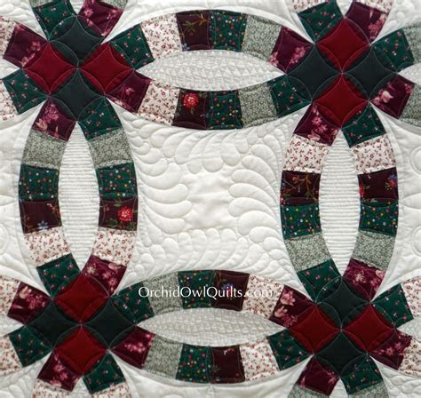 Double wedding ring quilt, longarm quilting: Orchid Owl