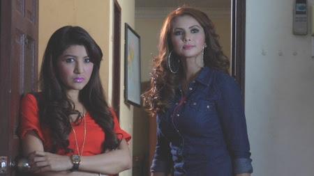 Rozita Che Wan sebagai Baidah dan Bea Rameshan sebagai Azila