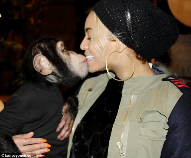 Kiss me: The pop superstar snuggled up to one hairy friend and couldn't have looked happier