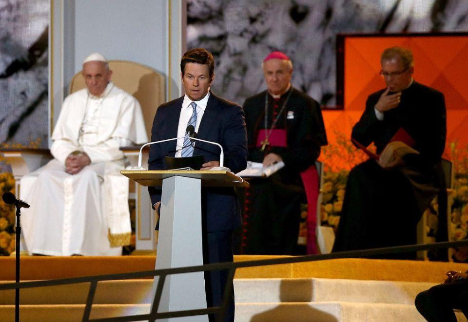 PHILADELPHIA, PA - SEPTEMBER 26: Actor Mark Wahlberg (C) speaks as Pope Francis (L) speaks during the Festival of Families on September 26, 2015 in Philadelphia, Pennsylvania. Pope Francis is wrapping up his trip to the United States with two days in Philadelphia where he will attend the Festival of Families and will meet with prisoners at the Curran-Fromhold Correctional Facility. (Photo by Carl Court/Getty Images)