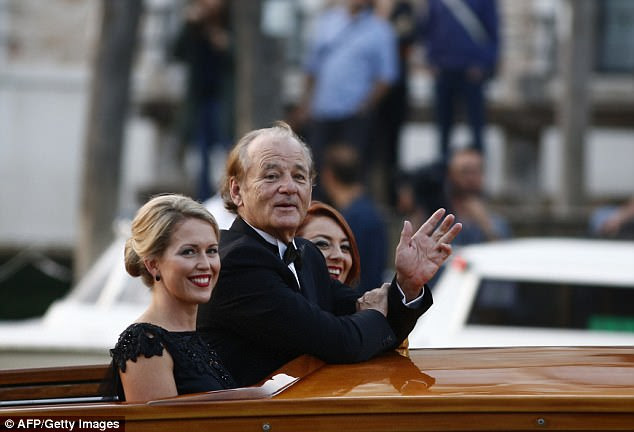 Ms Robinson, left, is a close friend of Amal Clooney and attended her wedding to George in 2014. She is pictured with fellow guest Bill Murray arriving in Venice via boat