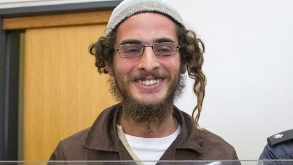 Meir Ettinger, the head of a Jewish extremist group, stands at the Israeli justice court in Nazareth Illit on Tuesday, a day after his arrest. Ettinger, 23, is the grandson of Rabbi Meir Kahane, Israel's most notorious Jewish extremist.