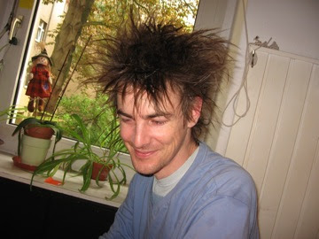 Keith, hair drying post-bike ride in the rain to our recording session....