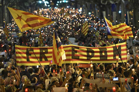 Spain to seek suspension of Catalonia's autonomy unless leader backs down