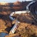 Train cars were lying nearly on their sides after the derailment along the Hudson River.