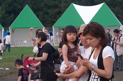 Parents are more interested in Gundam statue than little girl