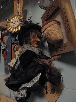 La Befana riding a broomstick.