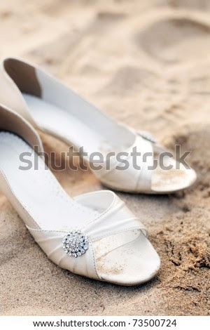 stock photo bridal shoes on left sands in a beach wedding party