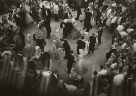 Newport socialites and debutantes dance at the Breakers Ball in 1959. The guests, in white powdered whigs, bright gowns and tuxedos, range from millionaires to heiresses to senators to diplomats. The ball was a fundraiser ball, held by the Preservation Society. Guests paid a thousand dollars a person to attend.