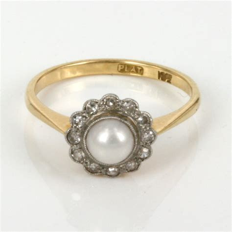 Antique pearl and diamond ring in 18ct gold and platinum