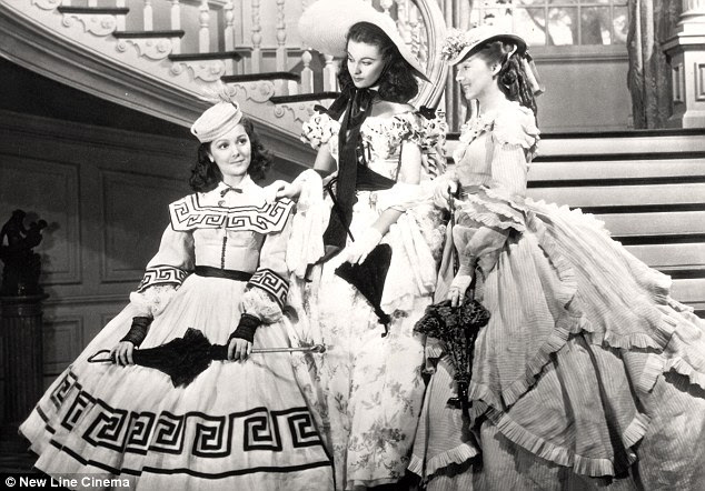 Iconic role: Rutherford, left, with co-stars Vivien Leigh and Evelyn Keyes in a scene from her famous 1939 movie Gone With The Wind