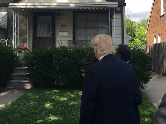 Carson shows Trump the home he grew up in as a kid in Detroit.
