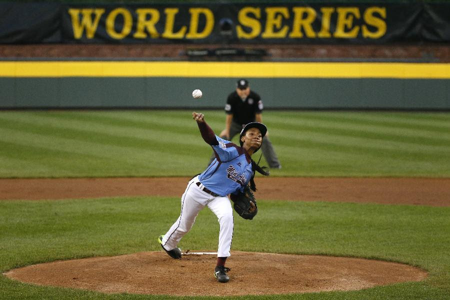 Philadelphia pitcher Mo'ne Davis delivers in the first inning of a United States semi-final baseball game against Las Vegas at the Little League World Series tournament in South Williamsport, Pa., Wednesday, Aug. 20, 2014. (AP Photo/Gene J. Puskar)