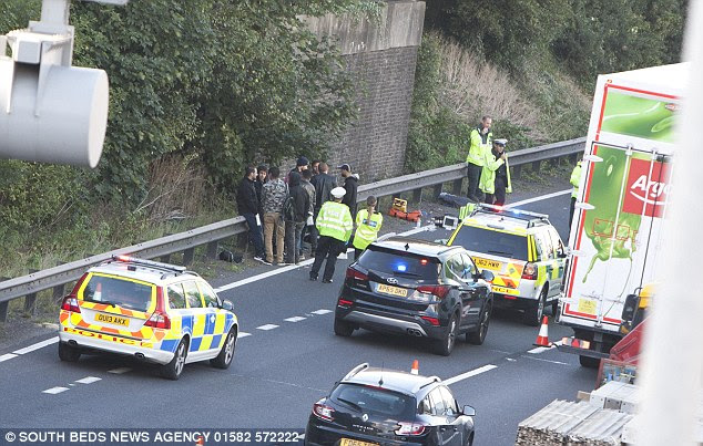 The scene on the M1 where 16 people were detained after reports that immigrants were travelling in a lorry. It is not yet known if the people pictured were the people arrested