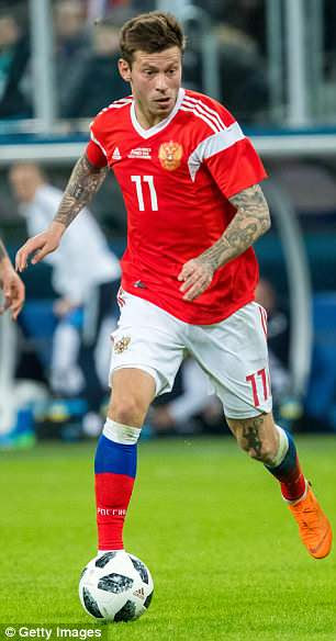 Russia have reverted to a lighter red for the World Cup with a patterned white away strip