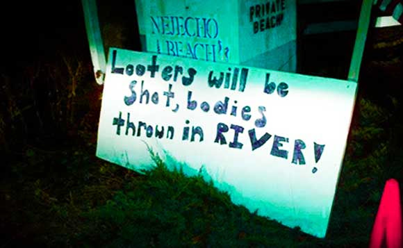 looters will be shot sign