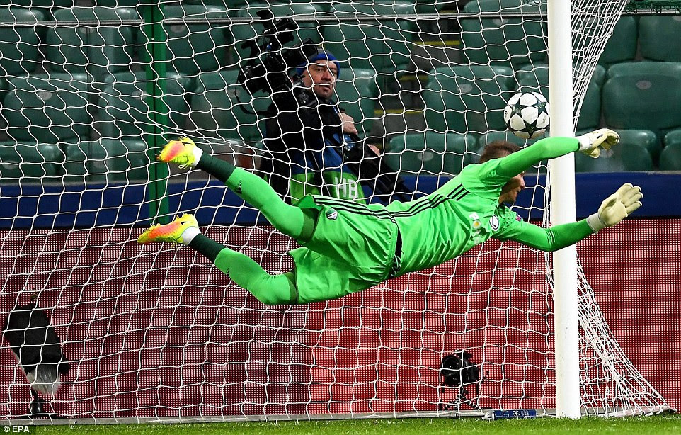 Legia Warsaw's goalkeeper Arkadiusz Malarz is left powerless to keep Bale's first-time strike from hitting the back of the net