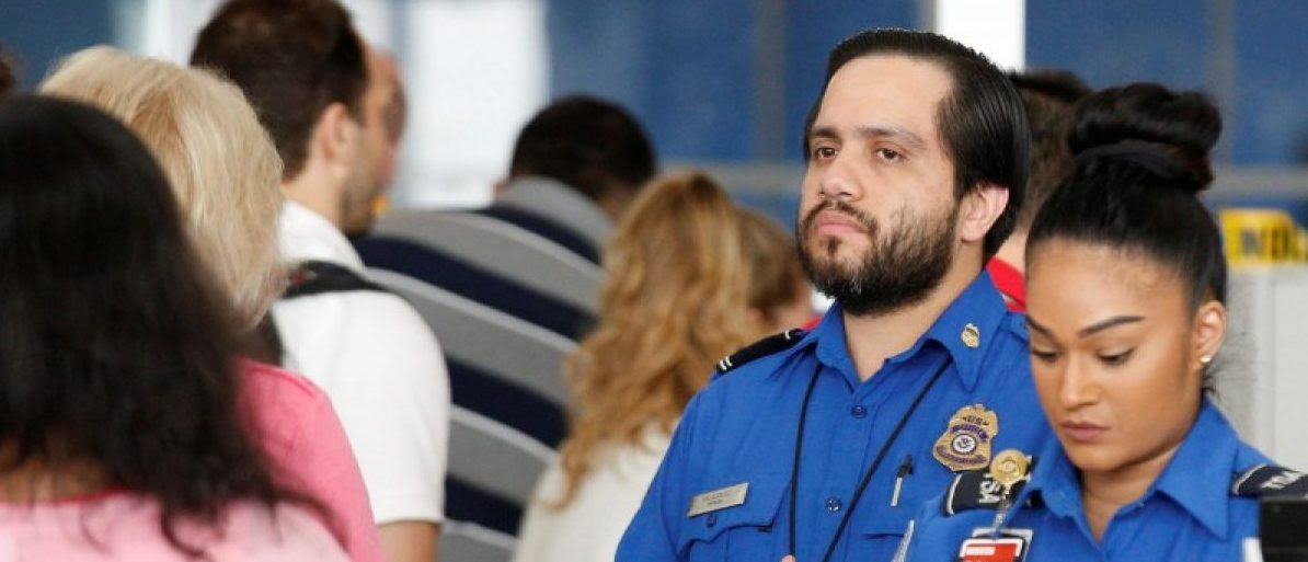 Transportation Security Administration workers are pictured in New York. REUTERS/Brendan McDermid/File Photo