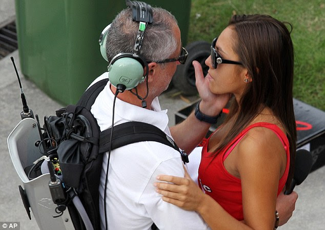 Support: Simoncelli girlfriend Kate is consoled by a TV crew member following her partner's tragic crash
