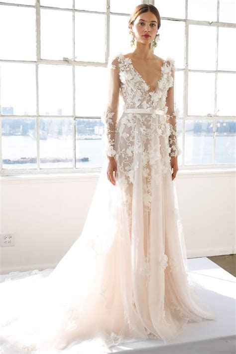Picture Of an off white floral applique wedding dress with