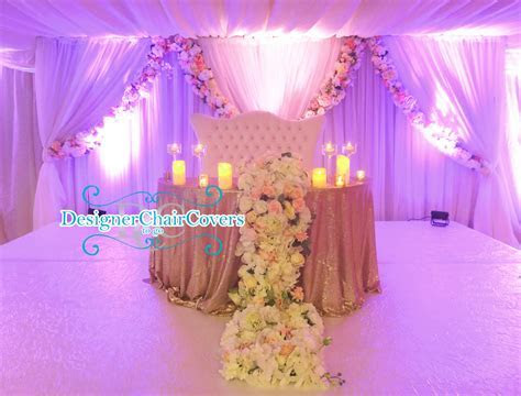 The sweetheart table with cascading flowers   Designer