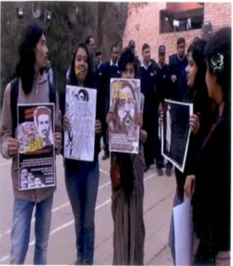 students with Afzal poster