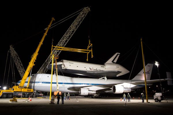 At JFK International Airport, Enterprise is about to be demated from NASA 905 during the night of May 12, 2012.