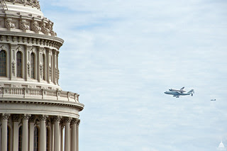 Close up of the U.S. Capitol Dome and Shuttle Discovery